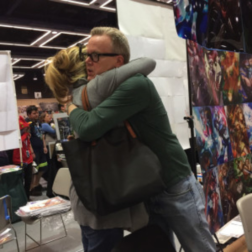 Susan hugs Bruce Timm at Emerald City ComiCon